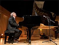Darius Brubeck playing grand piano